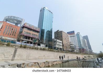 SEOUL, KOREA - JUNE 10: Unidentified tourist visit fountain at Cheonggyecheon stream on June 10, 2013, Seoul, Korea. Cheonggyecheon is the result of a massive US$ 281 million urban renewal project.
