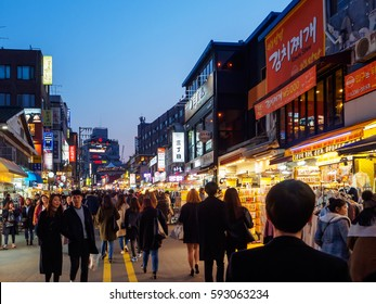 SEOUL, KOREA - MARCH 04, 2017 - Group of people tourist are Shopping and walking at hongdae street market