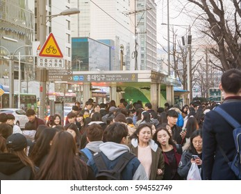 SEOUL, KOREA - MARCH 04, 2017 - People passing in front of the Hongik Univ subway station entrance