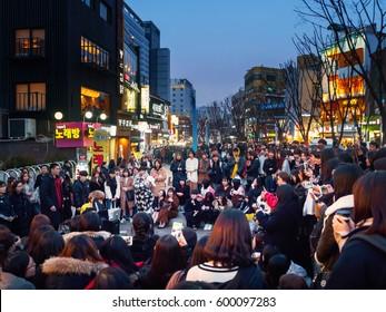 SEOUL, KOREA - MARCH 04, 2017 - Crowds watching street performances in Hongdae