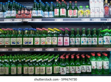 SEOUL, KOREA - MARCH 13, 2017: Soju bottles of various flavors displayed in the supermarket in South Korea.
