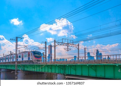 SEOUL, KOREA - MARCH 23, 2019:Beautiful Sky and Seoul Subway train with 63 building Seoul, South Korea.
