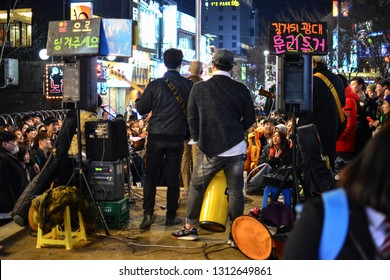 Seoul, Korea - March 5, 2015 : large crowd of people are watching outdoor mini concert at Hongdae street, Hongdae It is known for its urban arts, indie music culture, clubs and entertainments