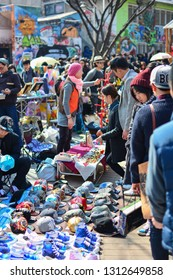 Seoul, Korea - March 7, 2015 : crowd of tourist shopping at Hongdae Free Market located on Hongdae street, Free Market is a marketplace for young artists and sells only genuinely creative artwork