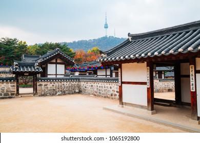 Seoul, Korea - November 04, 2016 : Korean traditional house and Namsan Seoul tower at autumn