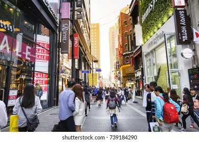 SEOUL, KOREA - OCTOBER 3, 2015 : Myeong-Dong shopping street, Korean people tourists walking shopping the neighbourhood. It is fashionable to be the most popular. neighbourhood is must when traveling.