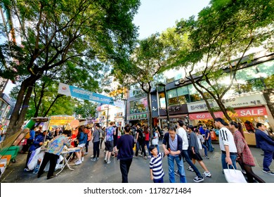 SEOUL, KOREA - OCTOBER 4, 2015 : Hongdae shopping street, Korean people tourists walking shopping the neighbourhood. It is fashionable to be the most popular. neighbourhood is must when traveling.