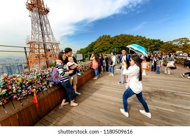 SEOUL, KOREA - OCTOBER 4, 2015 : Namsan Park, Unidentified tourists and family come to take pictures commemorate and appreciate the beauty of Seoul, an activity not to be missed when visiting here.