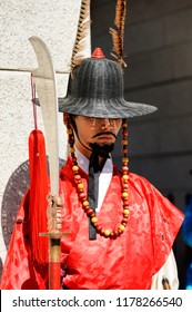 SEOUL, KOREA - OCTOBER 9, 2015 : Gyeongbokgung Palace, Unidentified man wears antiquities guarding the gate of the old palace with beautiful architecture. One of Korea's must-see places to visit.