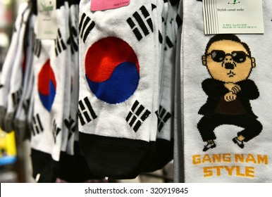 SEOUL, KOREA - SEPTEMBER 18, 2015: Night market booth with socks on sale featuring South Korean flag and Gangnam Style theme.