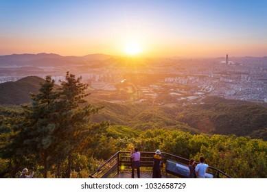 SEOUL, KOREA - SEPTEMBER 27, 2015: Seoul city skyline in sunset The best view at Namhansanseong Fortress.