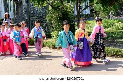 SEOUL, KOREA-SEPTEMBER 27, 2017: Korean preschool children in traditional Korean costumes walk on the streets of Seoul, South Korea