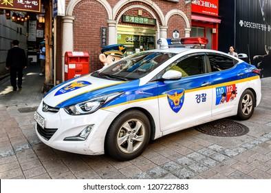SEOUL, KOREA-SEPTEMBER 27, 2017: Police car on the street in front of shopping mall in Seoul, South Korea