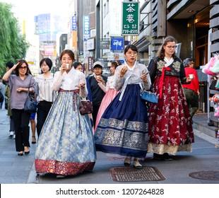 SEOUL, KOREA-SEPTEMBER 28, 2017: Korean Girls in traditional Hanbok dress walk on the streets of Seoul, South Korea