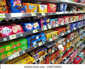 Seoul, KR - MAY 4, 2019: Many colorful cookies and snacks in supermarket shelf. They are one of a cause of the increase fat kids.