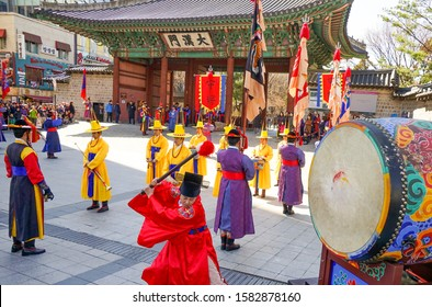 Seoul, March - 2019: Guard change ceremony at the Deoksugung Royal Palace. The drummer beats the big drum.