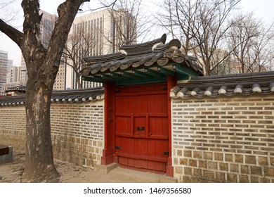Seoul, March - 2019: Small gate and stone wall of the palace building. Deoksugung Palace, Seoul.