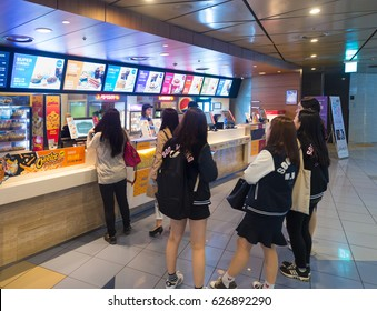 SEOUL - MARCH 29, 2017: Unidentified people buy food at a snack bar of the Lotte Cinema Yongsan. Lotte Cinema is a chain of movie theatres in South Korea.