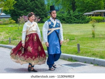 SEOUL - MAY 10 : Korean couple wearing Hanbok dress in Seoul Korea on May 10 2018. Hanbok is a Korean traditional clothing It is characterized by vibrant colors and simple lines