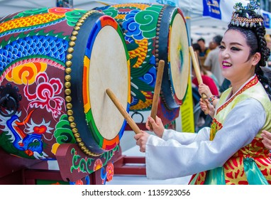 SEOUL - MAY 11 : A woman drumming in a drum at Jogyesa Temple during Lotus Lantern Festival in Seoul , Korea on May 11 2018  The festival is a celebration of the birth of Buddha