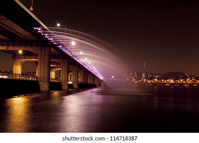 SEOUL - MAY 4: A night view of Banpo Bridge a on May 4, 2012 in Seoul, South Korea. This is the world's longest bridge fountain.
