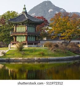 SEOUL - OCTOBER 21, 2016: Emperor palace at Seoul. South Korea. Lake. Mountain. Reflections on lake. Autumn time.