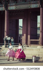 SEOUL - OCTOBER 21, 2016: Young girls in traditional dresses at Gyeongbokgung Palace of Seoul, South Korea.