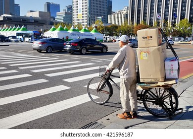 Seoul, Republic of Korea - 26 October 2015: Traffic in Seoul. Usage of bicycle helps with ecology and traffic jams.