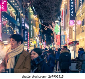 Seoul, Republic of Korea - January 1, 2015 : New Year with decoration lamp neon around street in  with crowd people focused on couple around  shopping street at night  in Seoul ,South Korea.