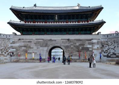 SEOUL, SOUTH KOREA - 1 DECEMBER 2018: Ceremonial guards in traditional Hanbok dress stand outside Namdaemun Gate (Sungnyemun Gate) designated South Korea's Number 1 national treasure