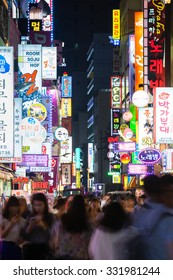 Seoul, South Korea - 14 August 2014: The view of the shopping street at night crowded with people and neon lights on 14 August 2014 in Seoul, South Korea.