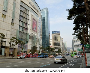 SEOUL, SOUTH KOREA - 2  DECEMBER 2018: Namdaemun-ro with the main branch of Lotte Department Store and the headquarters of KEB Hana Bank behind.
