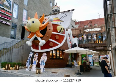 "Seoul, South Korea - 21 July 2018: A theme cafe of famous Japanese animation ""One Piece"" showing displayed decorations and model outside the shop."