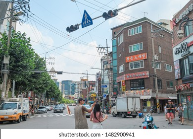Seoul, South Korea - 27 July, 2019  : Street view in Hongdae district. Hongdae is a community full of young, underground culture. Cafes, galleries, and fashion stores are a must-see for young people.