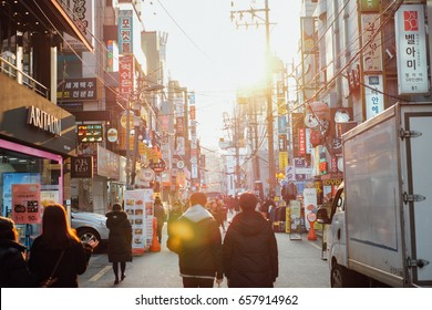 Seoul, South Korea 5 January 2016 : In Hongdae, people walking comeback home while sunlight by sunset