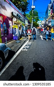 Seoul, South Korea - April 10, 2018: Tourist strolling in Street of Hongdae.