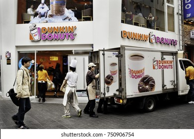 Seoul, South Korea - April 10, 2012: Workers unload a truck outside a Dunkin Donuts store in Seoul, South Korea. Dunkin' Donuts is an international doughnut and coffee retailer