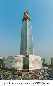 SEOUL, SOUTH KOREA - APRIL 11: Lotte World Tower under construction on April 11, 2015 in Seoul, South Korea. The tower is due to open in October, 2016.