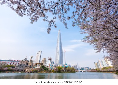 Seoul, South Korea - April, 13: Lotte world tower and Seokchon lake in spring with cherry blossom.