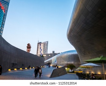 Seoul, South Korea - April 16, 2018: People and touristor visits Dongdaemun Design Plaza (DDP). The newest and most iconic landmark of the Korean design industry with modern interior curve shape.