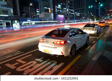 SEOUL, SOUTH KOREA - APRIL 16, 2019 : Neons, lights and Taxis waiting for customers, night urban scene on Gangnam Daero Avenue.