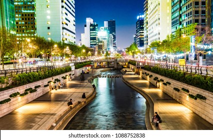 Seoul, South Korea - April 17, 2018: Colorful of Cheonggyecheon Stream Park at night. Cheonggyecheon canal is a famous landmark in Seoul, South Korea. Full of people relaxing at here.