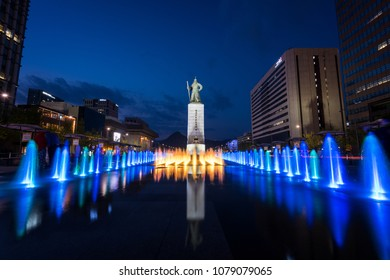 Seoul, South Korea - April, 2018:  Statue of Admiral Yi Sun-Shin  and colour floor water fountain in Gwanghwamun plaza.