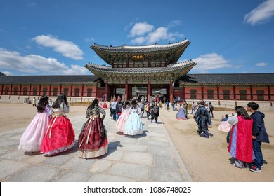 """Seoul, South Korea - April 2018 : Tourist wearing traditional dress """"hanbok"""" going to Gyeongbokgung Palace which is one of the most famous landmark in Seoul, South Korea"""