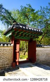 Seoul, South Korea - April 2018: Wooden gate and stone wall in Jongmyo Shrine.