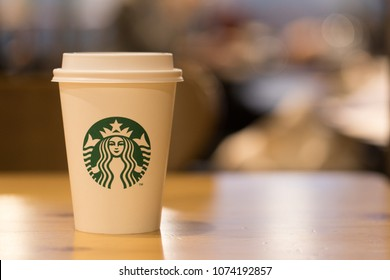 Seoul, South Korea - April 22, 2018: Starbucks Coffee Shop's hot beverage cup, bright and cloudy background, Starbucks has 21,891 stores in 62 countries around the world