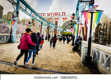 Seoul, South Korea - April 6, 2018: Crossing the bridge from Lotte World Magic Island to the escalator leading back to Lotte World.