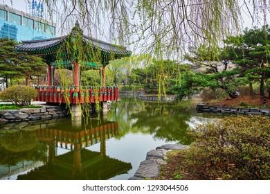 SEOUL, SOUTH KOREA - APRIL 8, 2017: Yeouido Park public park pond with pavilion summerhouse in Seoul, Korea