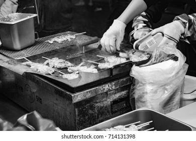 Seoul, South Korea - APRIL 8, 2017: Street food is being prepared at Myeongdong market, Korea.