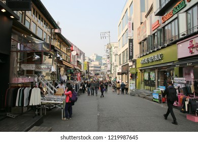Seoul, South Korea - April 9, 2015 : Local shops - lined at Hongdae (Hongik University) shopping street. Hongdae is a shopping cultural street for young people in Seoul.